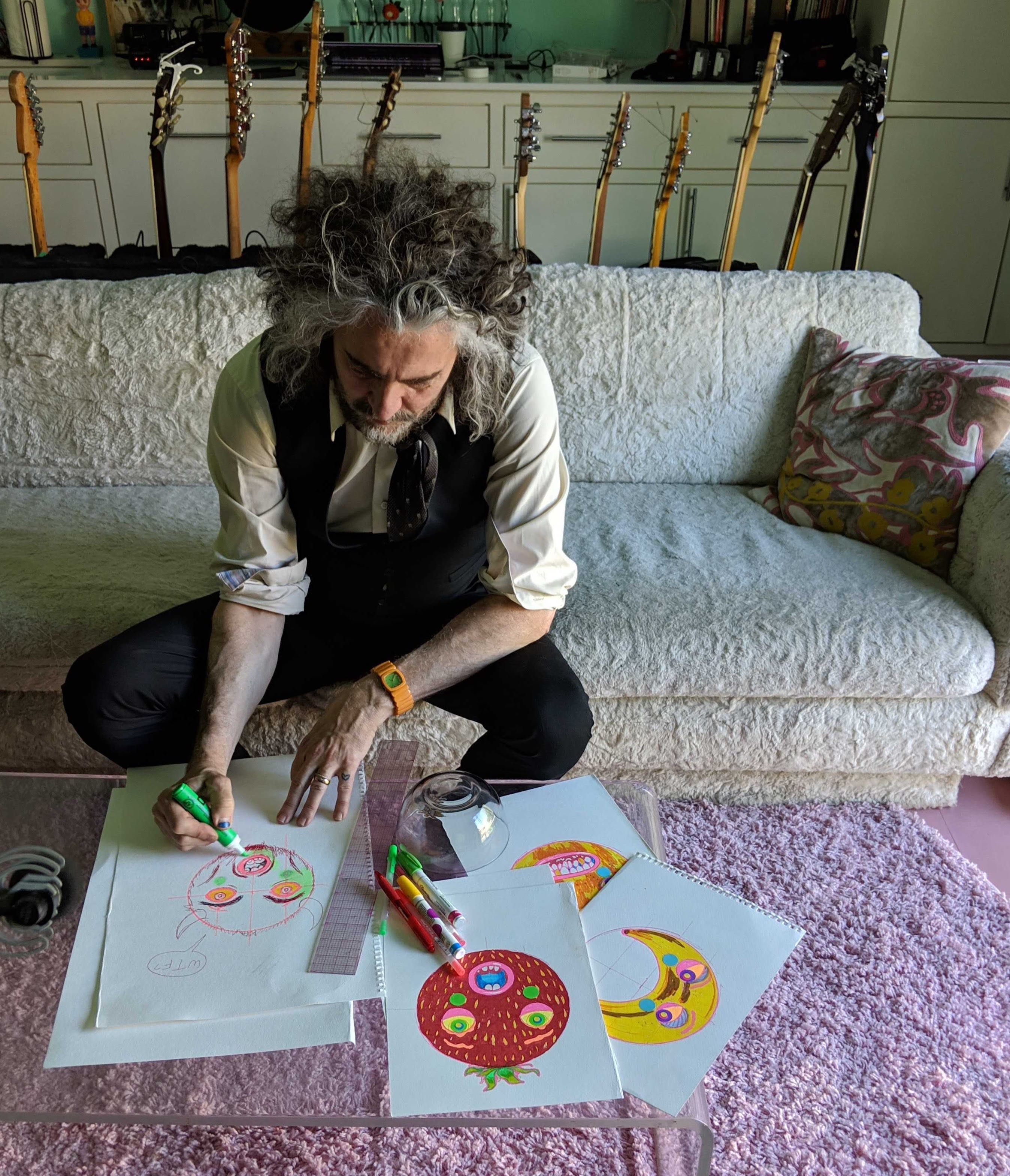 Wayne Coyne (The Flaming Lips) sketches designs for the inflatable fruit.